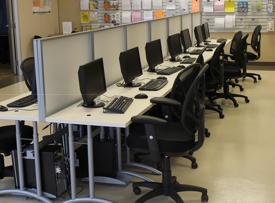 Alternate view of many computer terminals in CERC resource room.